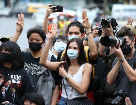 epa08582184 Thai student and pro-democracy activists flash the three-fingered salute for anti-government, as they take part on a Harry Potter themed pro-democracy protest against the government near the Democracy Monument in downtown Bangkok, Thailand, 03 August 2020. The pro-democracy activists gathered to protest the government and to call for change. EPA/NARONG SANGNAK